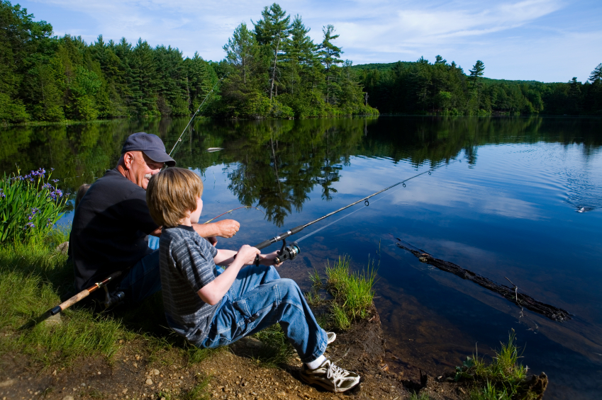 A grandfather and grandson fishing