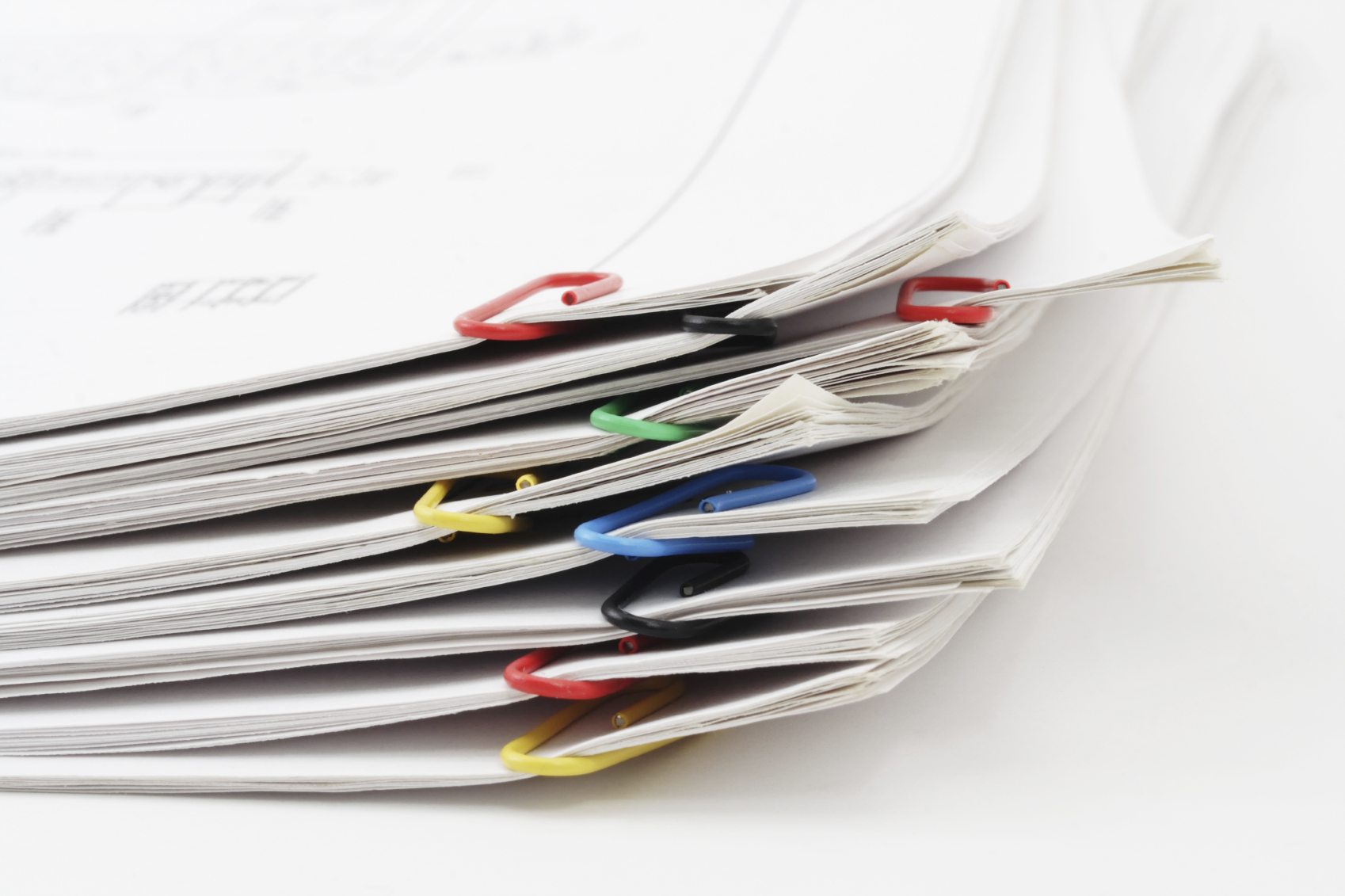 Pile of sheets of paper fastened by paper clips Foto: © Gala_Kan